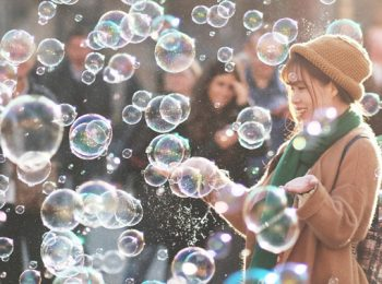 woman standing outside with bubble all around