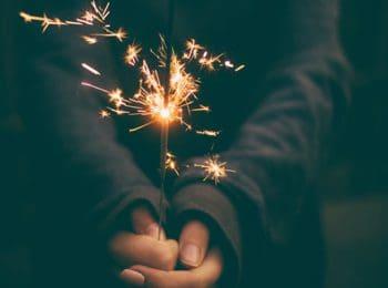 hands holding sparkler