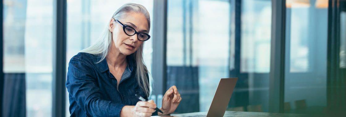 Woman executive working at laptop